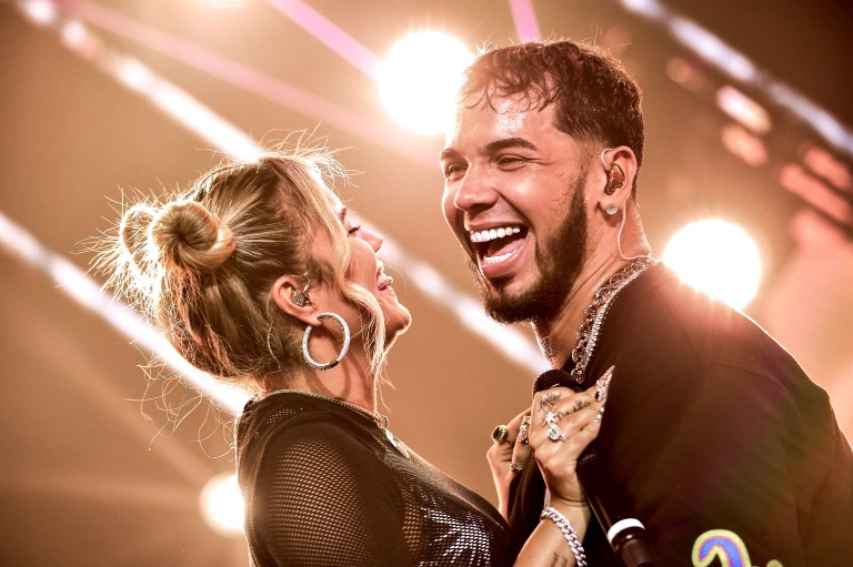 NEW YORK, NY - NOVEMBER 17:  Karol G and Anuel AA perform live on stage during Anuel AA & Karol G In Concert at United Palace Theater on November 17, 2018 in New York City.  (Photo by Steven Ferdman/Getty Images)