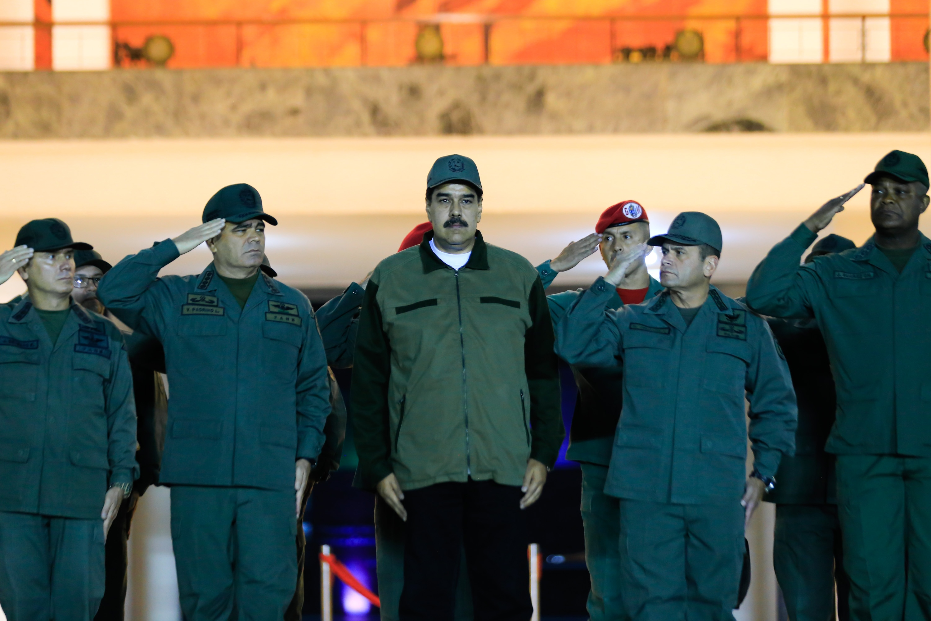 """This handout picture released by Miraflores Palace press office shows Venezuela's President Nicolas Maduro (C) receiving the military salute from loyal troops at the """"Fuerte Tiuna"""" in Caracas, Venezuela on May 2, 2019. - Maduro attends a """"march to reaffirm the absolute loyalty"""" of the Venezuelan Army, as opposition leader Juan Guaido continues making calls to oust his government. (Photo by HO / Presidency/JHONN ZERPA / AFP)"""